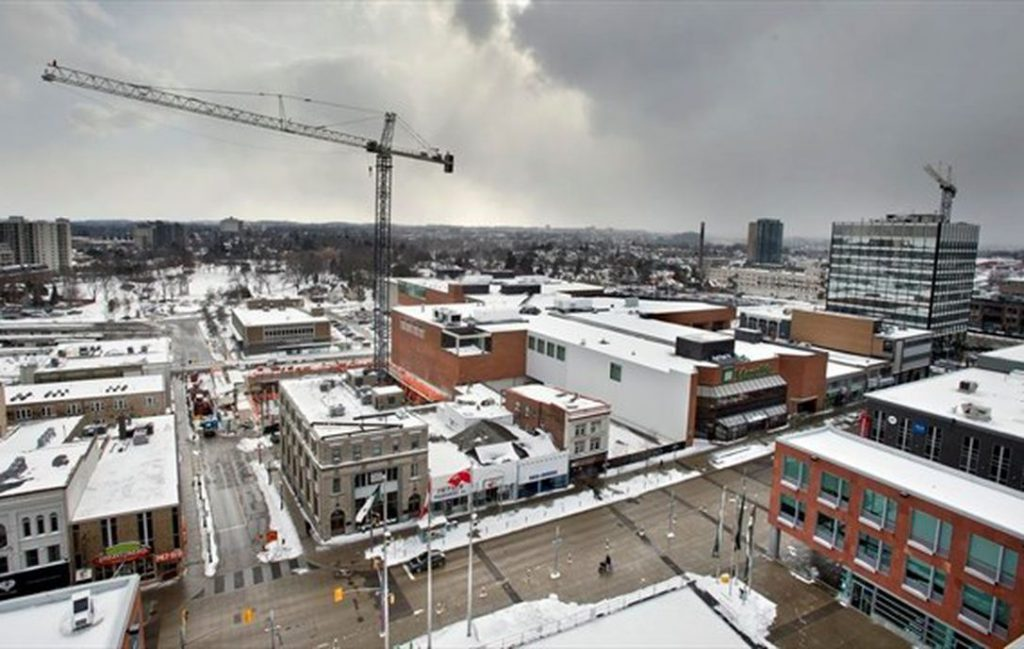 View of Downtown Kitchener with multiple cranes on new construction sites